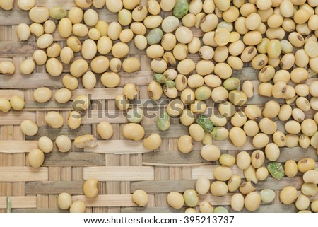 Soya bean organic on bamboo woven for background - stock photo