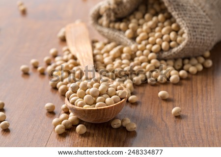 soya beans on wooden surface - stock photo