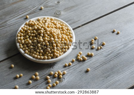 Soybeans on a wooden background. Rustic style. Copy space. Health and diet concept. - stock photo