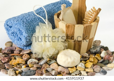 Spa accessories on sea pebbles on white background - stock photo