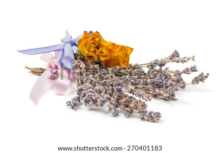 Spa Accessories, yellow dried roses with two bunches of lavender with ribbon isolated on white - stock photo