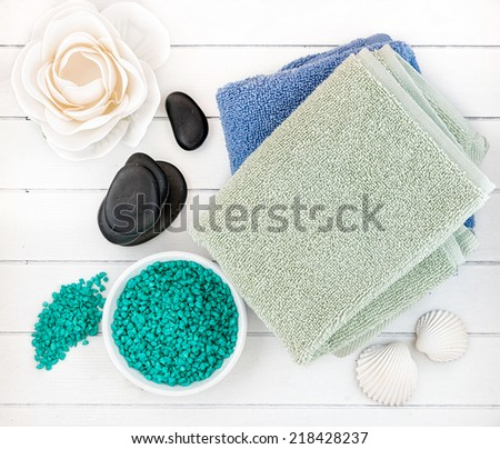 Spa and bath accessories with candles, towel and sea salt - stock photo