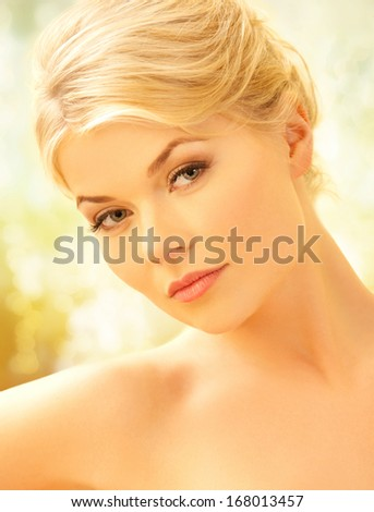 spa and beauty concept - beautiful woman covered with towel in spa salon - stock photo