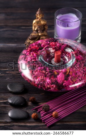 spa and meditation. Incense sticks,  Zen stones, Buddha statue. - stock photo