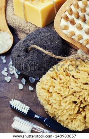 Spa and Wellness-bath brush, sponge, towel, sea salt, pumice stone and soap over white  - stock photo