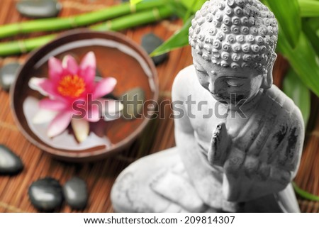 Spa and wellness setting with buddha and flowers,Shallow Dof. - stock photo