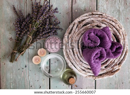 Spa and wellness setting with lavender flowers; floral water and bath salt. Dayspa nature set;  - stock photo