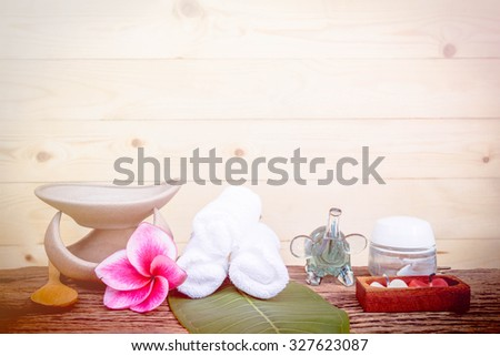 Spa and wellness setting with natural bath salt, candles and towel. made with color filters,blurred focus - stock photo