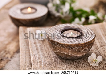 Spa and wellness setting with natural soap, candles and towel. Beige dayspa nature set with copyspace - stock photo