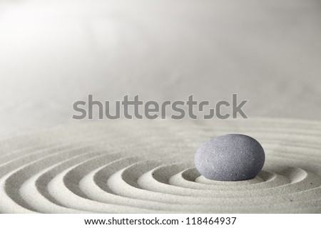 spa and zen background relaxation and meditation concept for purity spirituality serenity calmness peaceful harmony simplicity relax sand and stone with lines and copyspace - stock photo