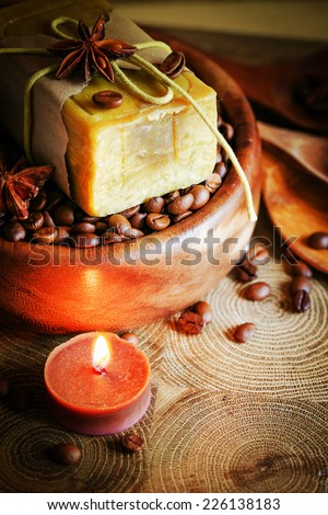 spa aroma massage setting with coffee and candlelight - stock photo