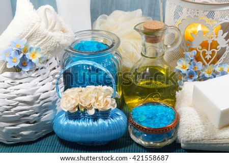 SPA - Aromatic sea salt and scented soap, scented candles and massage oil and accessories for massage and bath - stock photo