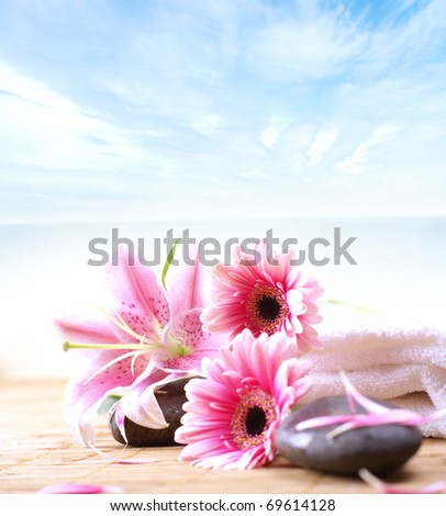 Spa background of flowers, stones and towel - stock photo
