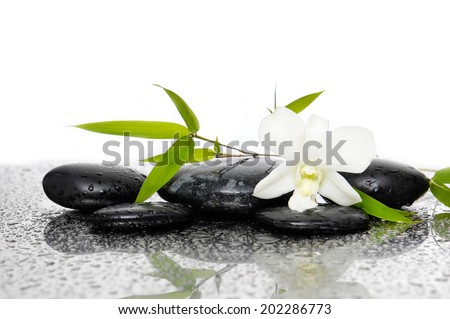 Spa Background with Bamboo and stones with white orchid flower - stock photo