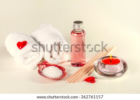 Spa background with erotic massage oil and towels. Toned image. - stock photo