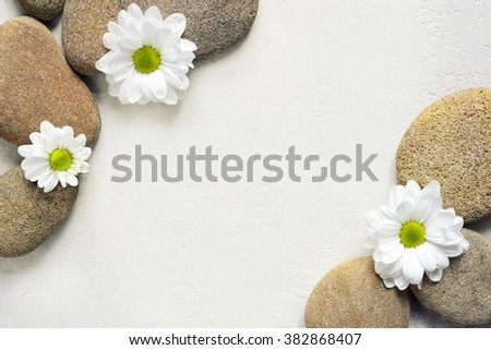 Spa background with stones and white flowers, view from above - stock photo