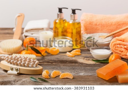 spa background with tangerines - stock photo