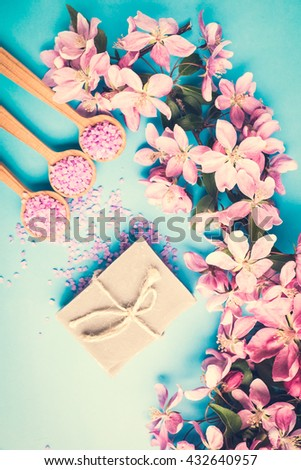 Spa bath cosmetic. Soap beauty treatment background. Aromatherapy with natural salt, soap, flower branch. Hygiene and relaxation for body. White towel. Luxury therapy and care. - stock photo