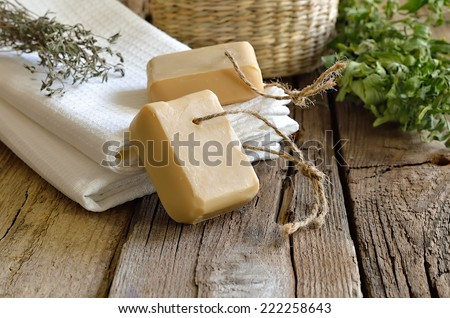 Spa bath set with handmade herbal soap - stock photo