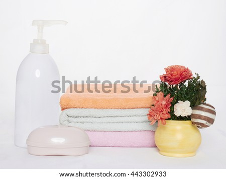 spa Bath still life.towels, cosmetics and flowers - stock photo