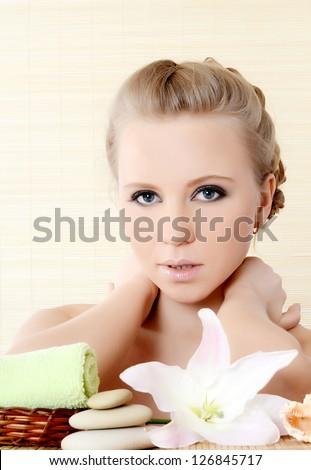 Spa beautiful Woman on a bamboo rug - stock photo