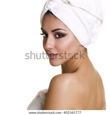 Spa. Beautiful young arabic woman in white towel, isolated over white background  - stock photo