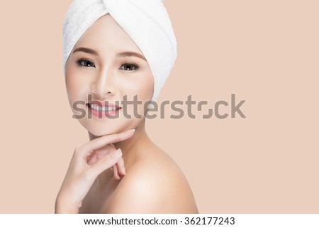 Spa beauty treatment woman smiling happy feeling soft towel on face. Closeup of beautiful cute Asian, Caucasian female model with perfect skin,  isolated with clipping path - stock photo