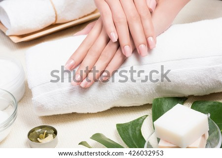 Spa.beauty woman hands with a bowl of aroma spa water on a table.Spa relaxation.Spa treatment.hands Spa,massage and spa salon.Thai spa.Beautiful hand.perfect nail.nail spa.Manicure concept. - stock photo