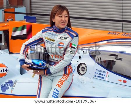 SPA, BELGIUM - MAY 2: Japanese female racing driver Keiko Ihara posing on her Gulf Racing car at circuit Spa-Francorchamps May 2, 2012 in Spa, Belgium. - stock photo