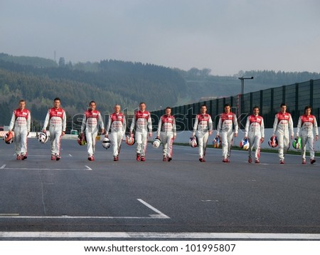 SPA, BELGIUM - MAY 2: The FIA WEC Audi drivers walking on the start/finish straight at circuit Spa-Francorchamps May 2, 2012 in Spa, Belgium. - stock photo