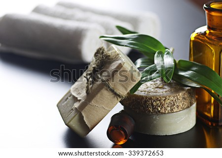Spa bottle green cloth - stock photo