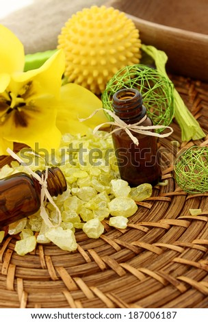 spa composition of bath salt, bottle and yellow flower - stock photo