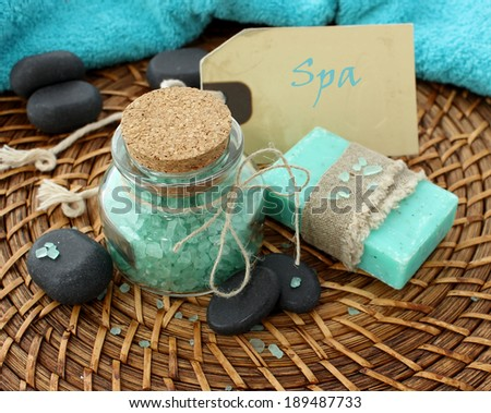 spa composition of bath salt, soap and stones - stock photo