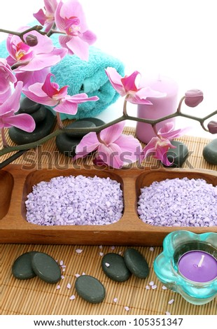 spa composition of bath salt, stones, candle and orchid flowers - stock photo