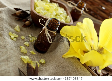 spa composition of bottle, bath salt and flower - stock photo