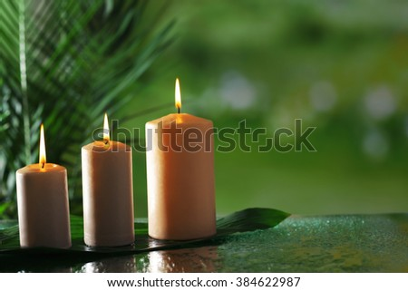Spa composition of candles, stones and bamboo on blurred background - stock photo