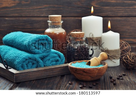 Spa composition with towels, candles and sea salt on wooden background - stock photo