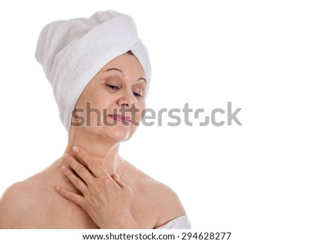 Spa concept. Aged good looking woman with white towel on her head - stock photo