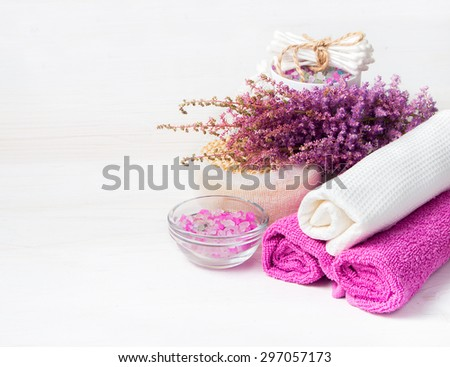 Spa concept. Flower, sea salt, towels  and objects for spa procedures on a white wooden background. - stock photo