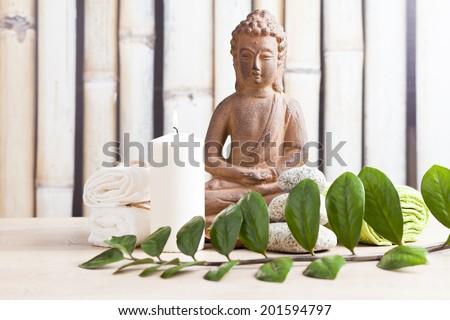 spa concept with buddha figure - stock photo