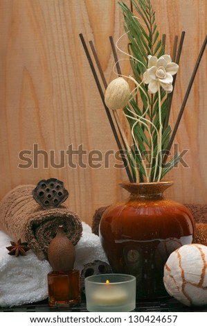 Spa concept with incense diffuser and cotton towels - stock photo