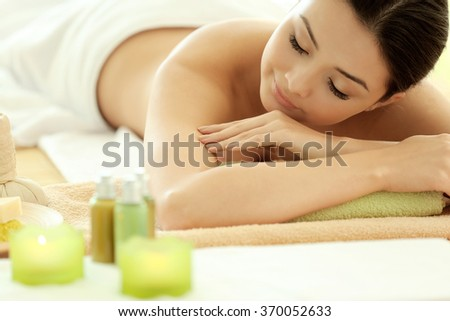 Spa concept. Young pretty woman relaxing, close up - stock photo