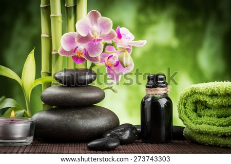 spa concept zen basalt stones ,orchid and candle - stock photo