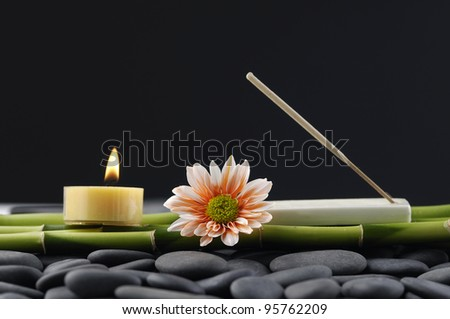 Spa Concept - Zen Stones and bamboo grove with candle - stock photo