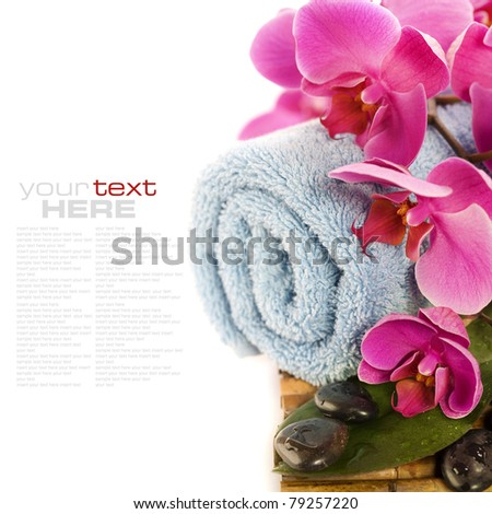 spa concept (zen stones, towel and orchid) over white with sample text - stock photo