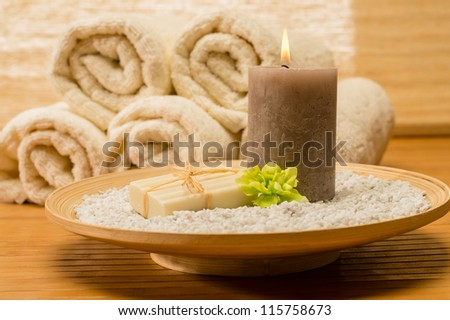 Spa decor wooden tray with candle and soap natural color - stock photo