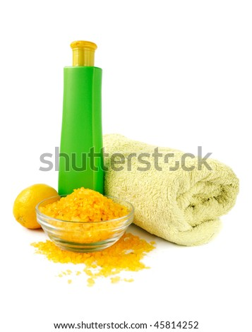 Spa essentials with sea salts for relaxation in yellow and green color - stock photo