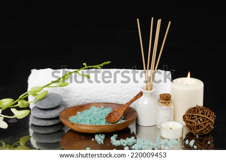 Spa feeling with towel ,salt in bowl ,candle , pebbles, orchid,bud - stock photo