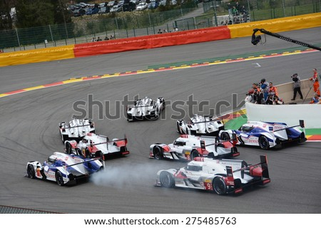 SPA-FRANCORCHAMPS, BELGIUM - MAY 2: The eight leading LMP1 cars in the first corner right after the start of the FIA World Endurance Championship race on May 2, 2015 in Spa-Francorchamps, Belgium. - stock photo