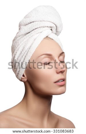 Spa grl. Beautiful young woman after bath. Perfect skin. Skincare. Young skin. Beautiful face of young woman with clean fresh skin close up isolated on white. Beauty portrait. - stock photo